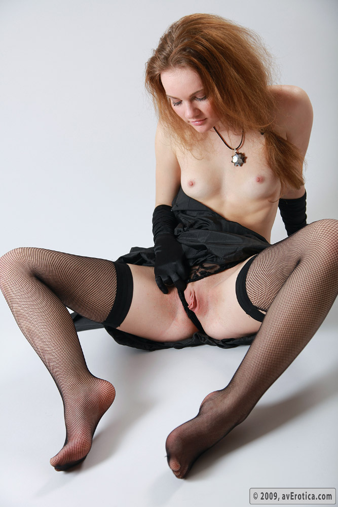 Redhead Teen In Ripped Stockings 65